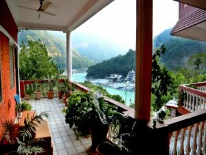 Common balcony for ganga view and deluxe rooms